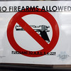 Arizona, the American West - a 'red' state - where firearms are something of the norm. A sign indicating no firearms are allowed in the restaurant. A month later, Congresswoman Gabrielle Giffords was shot in the head in Tuscon. A sad commentary on America.