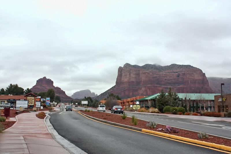 Approaching Sedona through Oak Creek Village under gray skies.