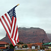 The red, white & blue against a red rock background.