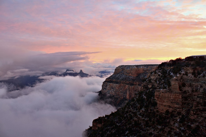 The sun rises as we look down upon the clouds from the south rim of Grand Canyon.  Облака над Больши Каньоном. Заря занимается....