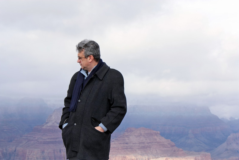 Contemplating the canyon's overwhelming vastness.