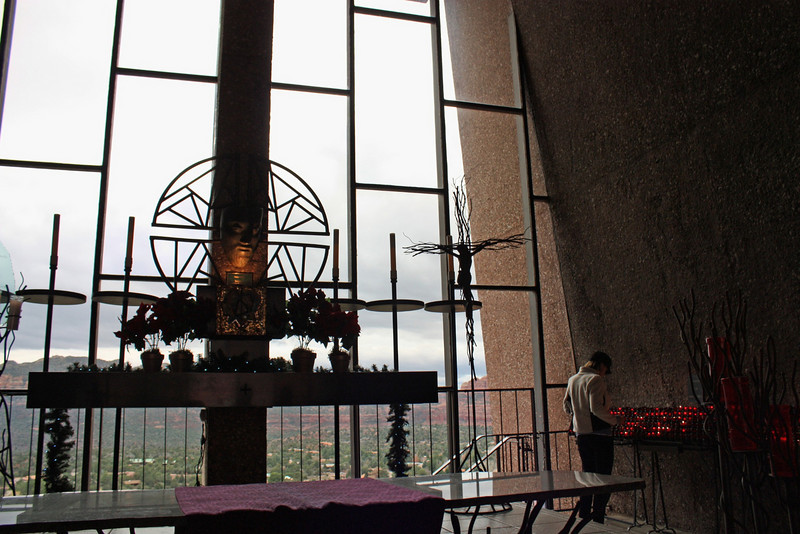 Lighting a candle at the Chapel of the Holy Cross. The chapel was completed in 1956. A serene place with panoramic views of the valley.