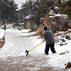 Shoveling snow outside the Bright Angel cabins.