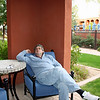 Rustem relaxing on our patio at the Montelucia across from the adults only pool.