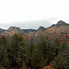The rocks of the Sedona area are limestone & sandstone. They get their red color from iron oxide.