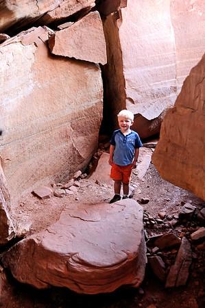 Brandon in the stone hallway