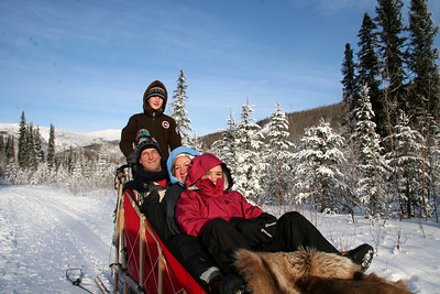 Elaine, Curtis, Debby, and Audrey stopping for a pose on our Dog Sled ride