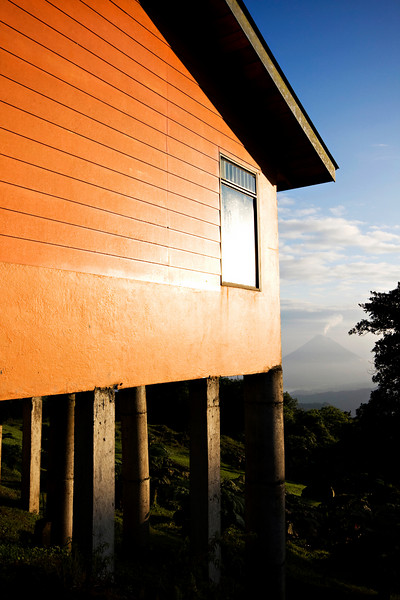 Mirador Lodge with the Arenal Volcano in the background.