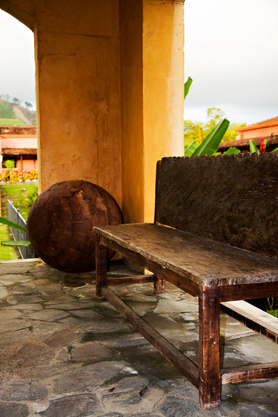 Old bench and wooden ball in front of the Marriott