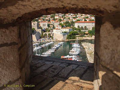 Looking thru the wall at the small boat harbor  in Dubrovnik