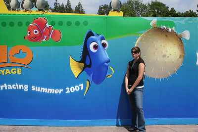 Sister in front of submarine ride construction wall