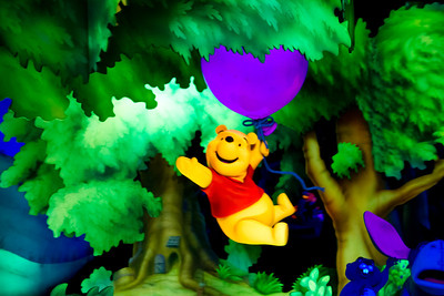 Pooh riding a Baloon