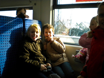 Our first train ride included a whole classroom full of kids being silly.