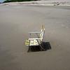 Beach chair in the sand.