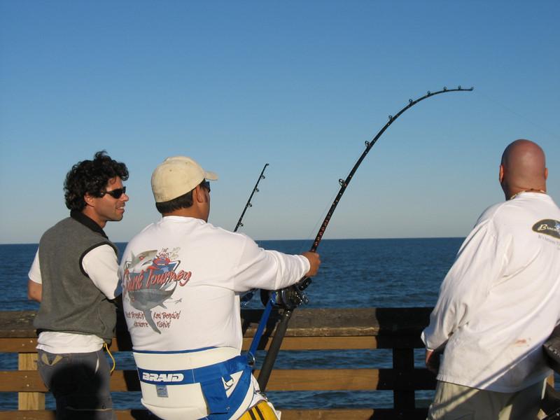 Bringing in something big. Juno Beach Pier. (2005)
