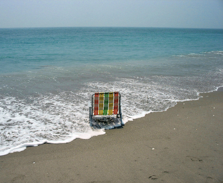 Beach chair in the surf. Susan's Place.