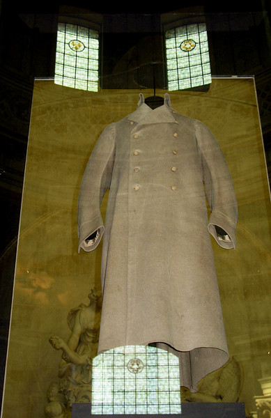 Napoleon's coat with reflection of stained glass windows.