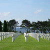 There are 9,383 U.S. service men & 4 women buried here. The cemetery remains U.S. territory.
