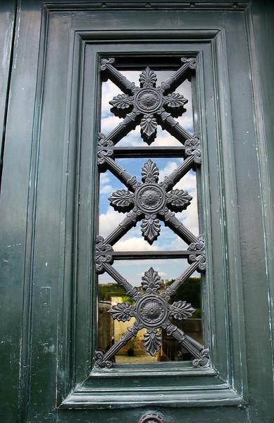 Door with sky reflection.