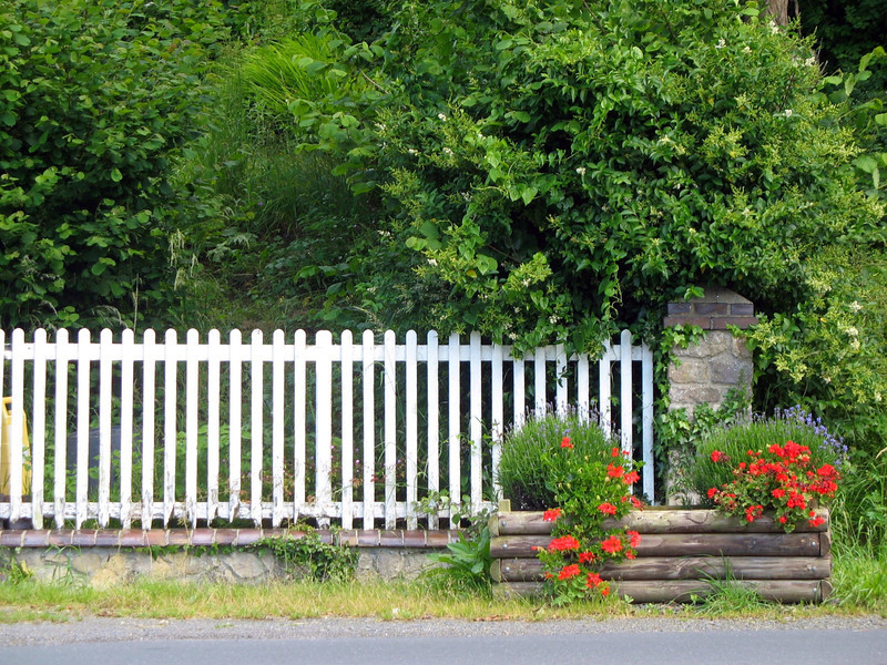 White picket fence across from the museum.