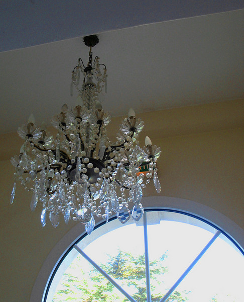 Chandelier, chateau stairwell.