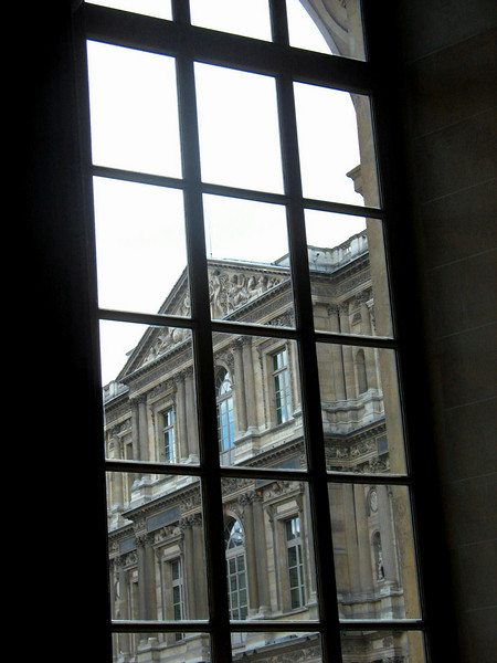 Looking out of a Louvre window.