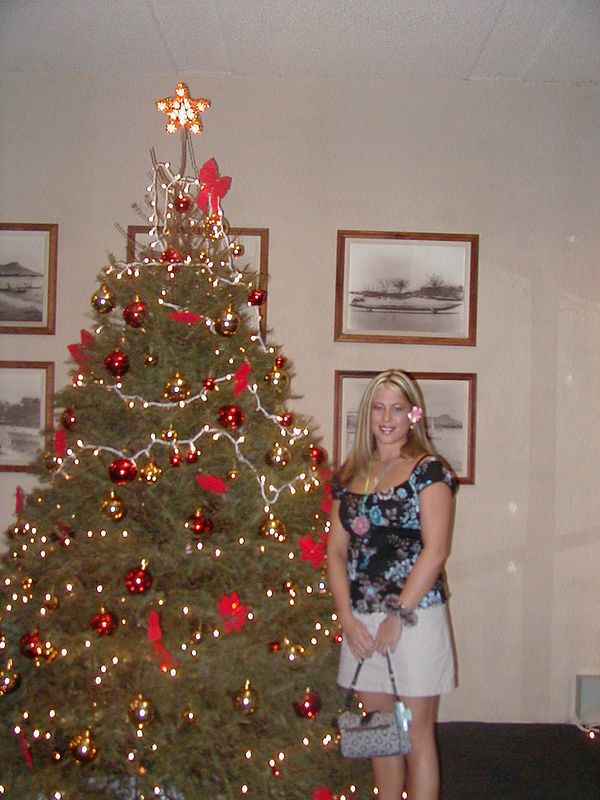 Me at my mom's apt in front of their tree in the lobby