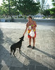 Carla feeds a stray dog in the town square of Cozumel.