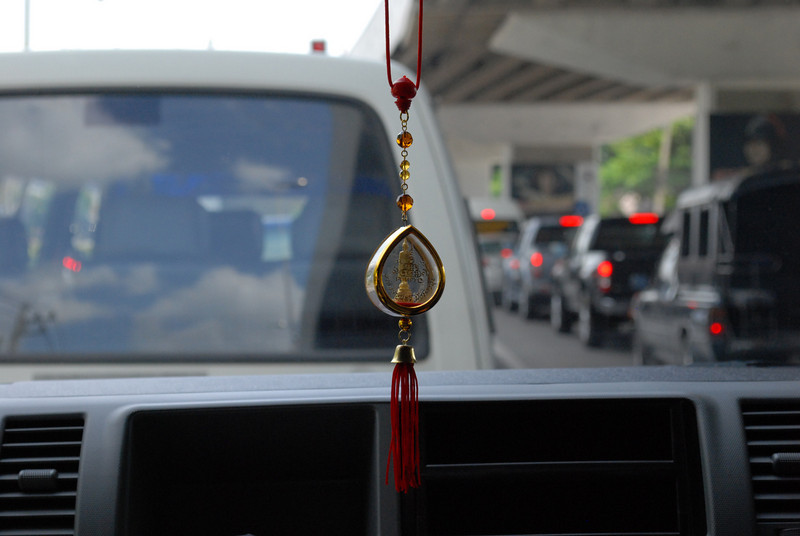 On our drive from the airport to the hotel and another Buddha hanging from the review mirror.