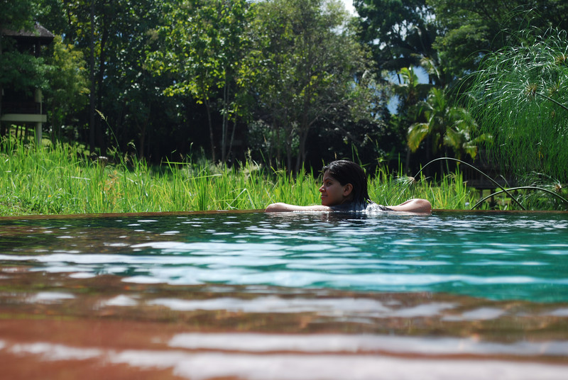 Ami relaxing in the infinity pool