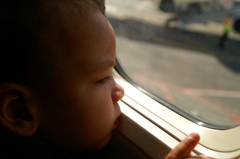 Tristan waits pensively for his first-ever plane trip to begin.
