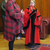 Belfast City Hall host shows off a royal robe with the help of a young model.