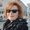 10-12-12 Kara on our gondola ride. You can see we're out in the lagoon with the Doge's Palace in the left background