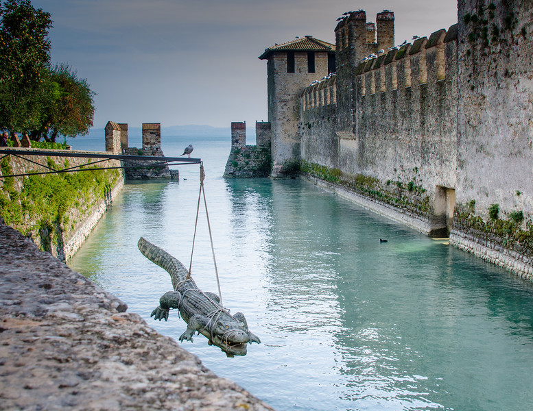 10-18-12 Sirmione:  I have no idea what this was about - and the hippo in the picture of Rosemary, plus other animal sculpures around town.