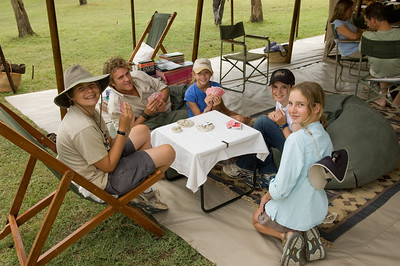 The kids (Audrey, Elaine, Kevin and Sara) playing cards with one of our guides, Tony