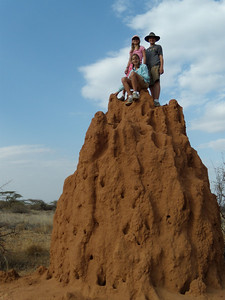 Elaine, Sara, and Kevin on top of a termite mound