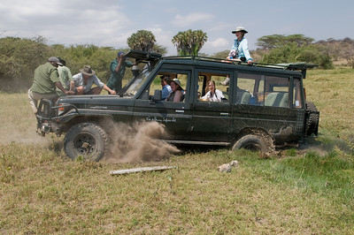 Trying to get the Land Cruiser unstuck with weight and rocking...