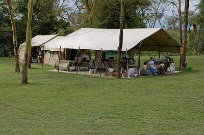 "The ""mess"" or dining tent which had a large dining table, buffet station, open bar area and casual chairs and bean bags for hanging out and playing games or reading"