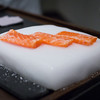 """Salmon being """"cooked"""" on a slab of dry ice at Guy Savoy. Very cool..."""