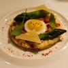 Onion tart with quails egg.