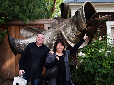 Tony and Stacy in front of a big metal fish