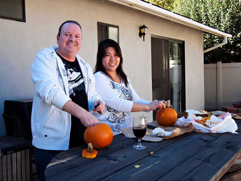 Tony and Stacy carving pumpkins