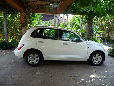 Our lovely white PT Cruiser...did fit all 5 of us but had a sad turning radius...don't bother buying this car