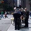 This just looked funny, they are all conducting business on a contructtion table on the street.