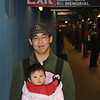 Man & baby waiting for the subway.