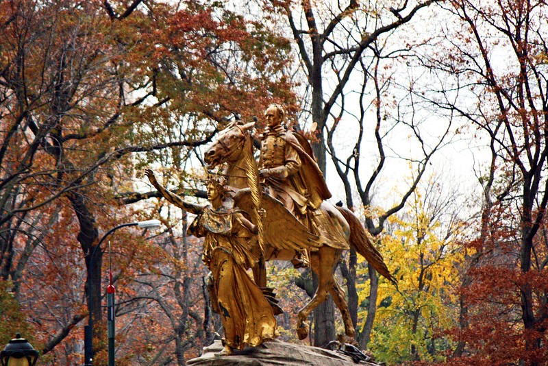 Gold statue near the entrance to Central Park.