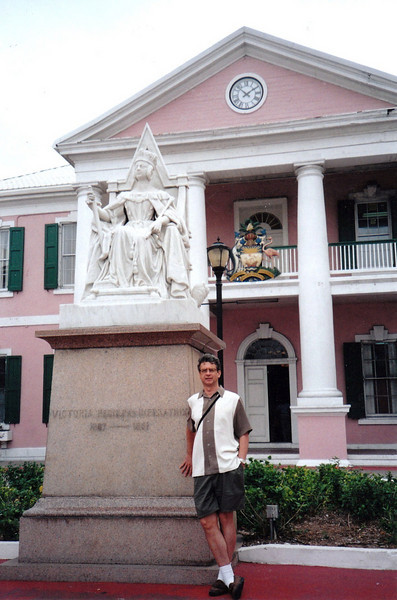 In front of Government House with Queen Victoria statue.