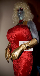 Alien Dolly Parton in drag