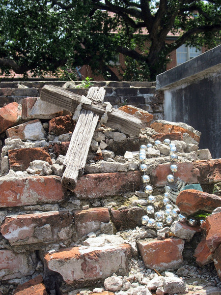 Crumbled tomb with cross & beads.