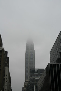 Empire State Building up in the clouds.
